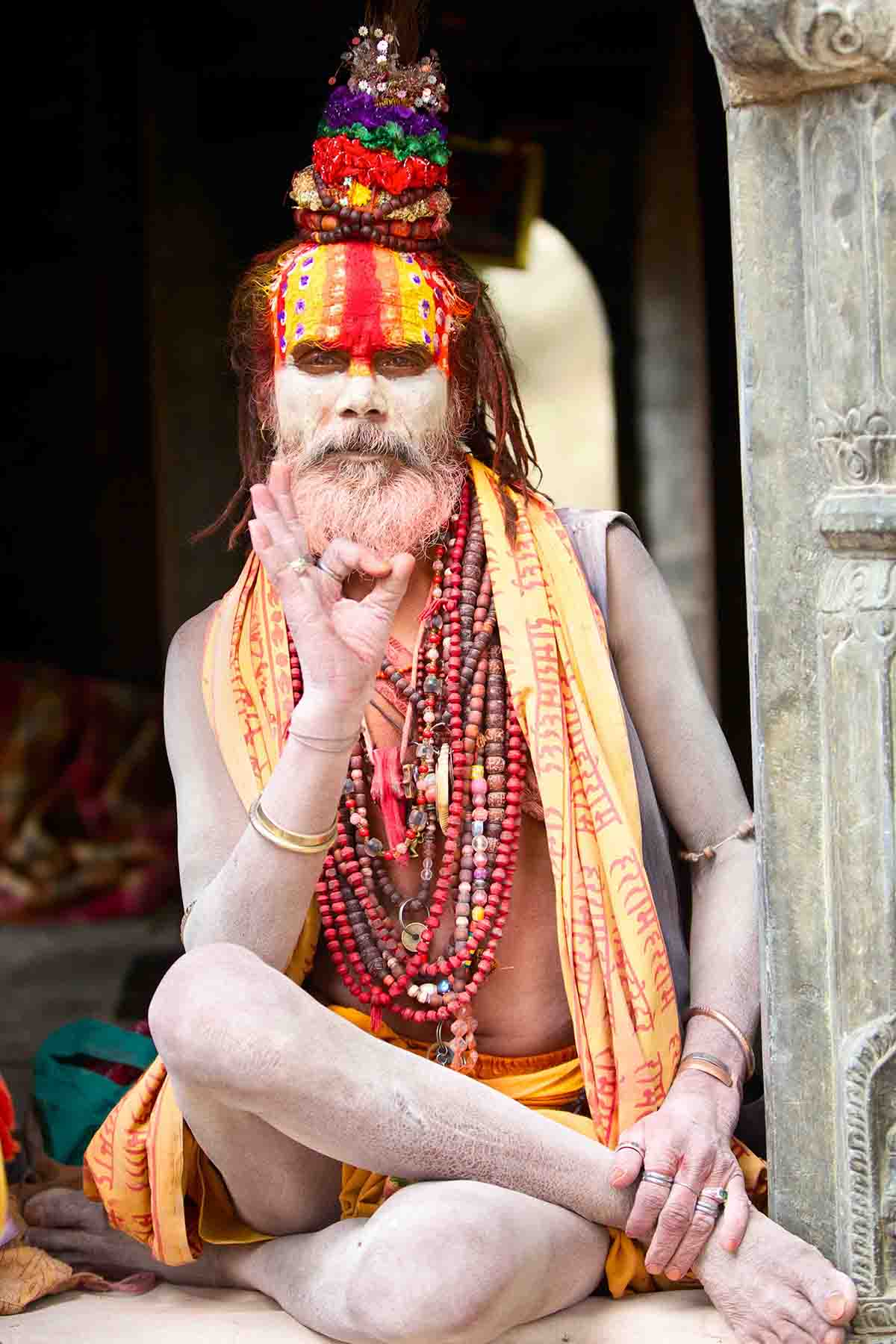 KATHMANDU, NEPAL - MAY 04: Holy Sadhu man with beard and traditional face paint sitting in Pashupatinath Temple on May 04, 2014 in Nepal, Kathmandu.